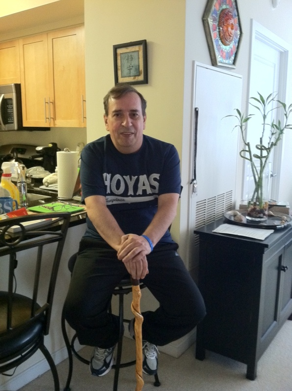 Here I am with my temporary, dapper walking stick, a brand new Hoyas T-shirt courtesy of a co-worker, and sitting in front of a Chinese symbol for Serenity with my Faith, Hope, Love cancer bracelet...ready to take on BEAR.